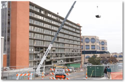 Construction crews prepare the student Dorm to be imploded Feb. 19 to make way for a hospital expansion and Psychiatric Research Institute.